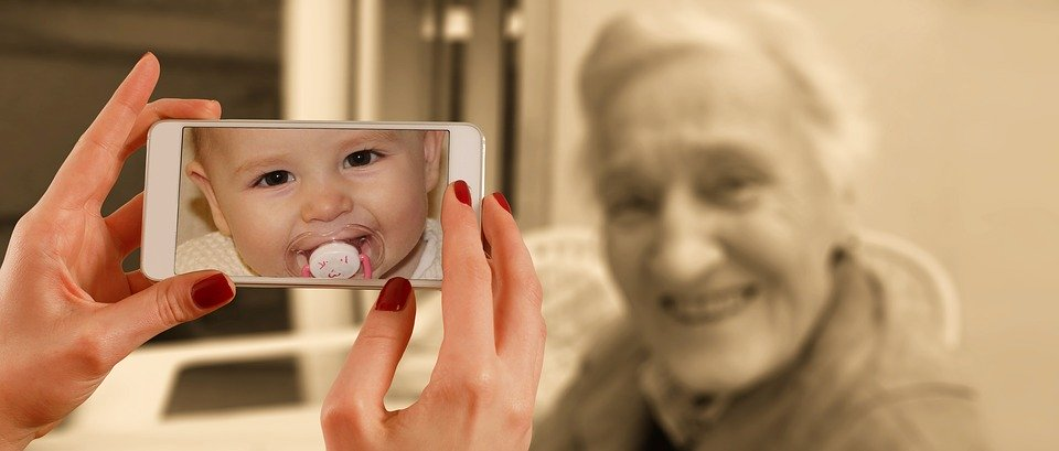 Smartphone photo of baby with elderly lady